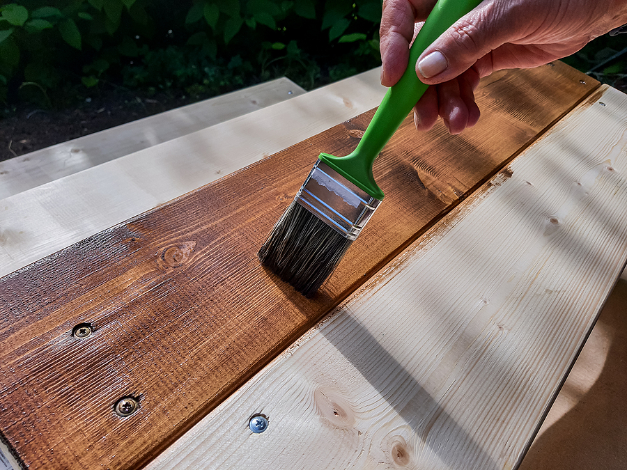 Applying Protective Varnish On A Patio Wooden Floor.painting Woo
